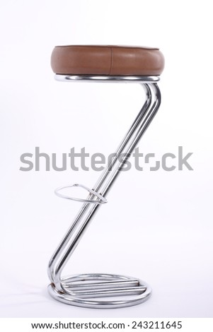 Shiny metal and brown leather bar stool