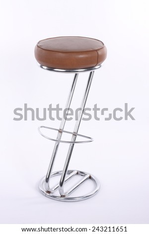 Shiny metal and brown leather bar stool - stock photo