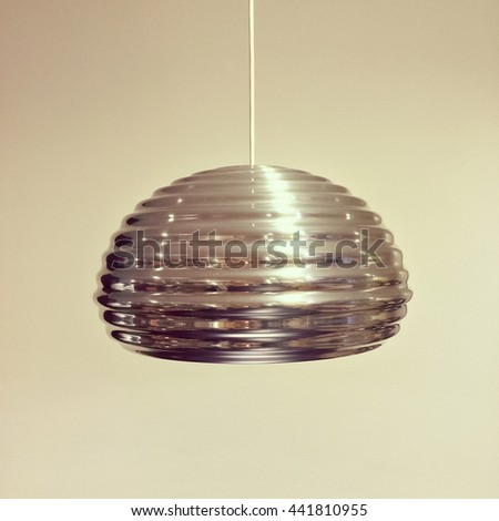 Shiny metal pendant lamp with modern design.
