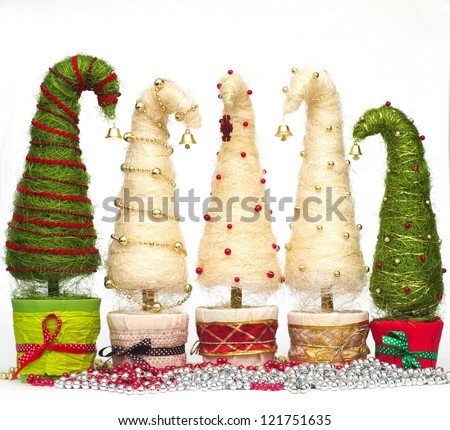 Shiny miniature Christmas trees made of sisal with beads - stock photo