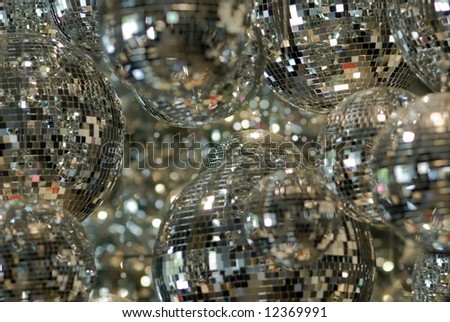 Shiny, mirrored disco balls in one of the european clubs. - stock photo
