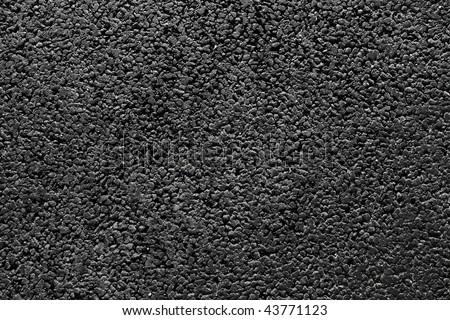 Shiny new black asphalt abstract texture background. - stock photo