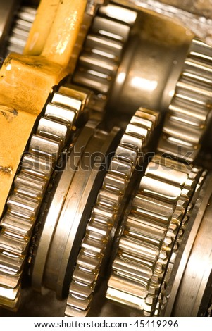 Shiny new cogwheels of an industrial machine. - stock photo