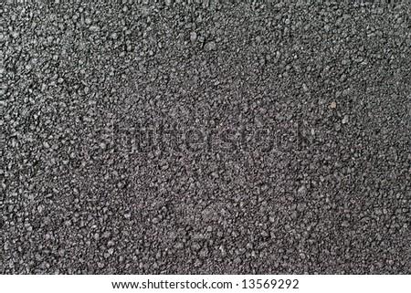 Shiny new warm asphalt abstract texture background - stock photo