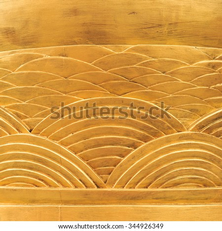 Shiny Old Golden Carved Wood of Arc Patterns around Column (background) - stock photo
