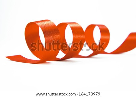 Shiny orange satin ribbon on white background with copy space. Macro with extremely shallow DOF. - stock photo