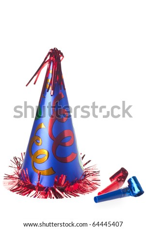 Shiny party hat and blowers on white background