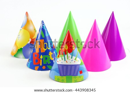 shiny party hats on white background