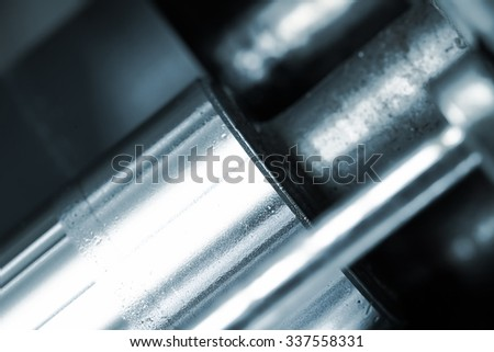 Shiny polished shaft. Fragment of the machine - stock photo