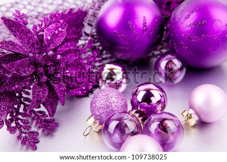 shiny purple christmas decoration on silver space for text - stock photo