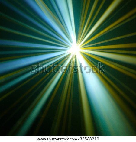 shiny rays in the darkness - stock photo