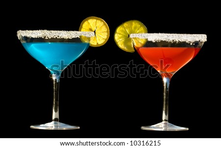 shiny red and blue drinks with salted rim showing lime and lemon on white table isolate on black background.