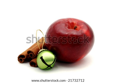 Shiny red apple and cinnamon sticks isolated on a white background. - stock photo