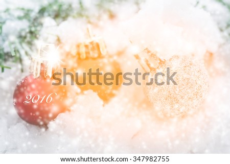 Shiny 2016 red Christmas balls  over snow background - stock photo