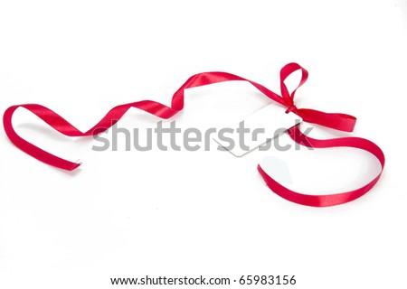 Shiny red ribbon bow on white background - stock photo