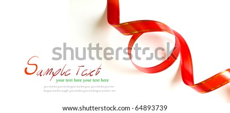 Shiny red ribbon curl on white background with copy space. - stock photo