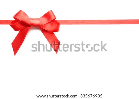 Shiny red ribbon with bow isolated on white