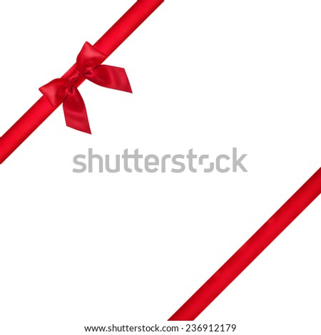 Shiny red satin ribbon and bow close up on white background  - stock photo