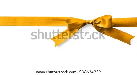Shiny satin ribbon in bright yellow gold golden color isolated on white background with clipping path: Realistic bow banner stripe fabric design decoration element X'mas holiday festive greeting card