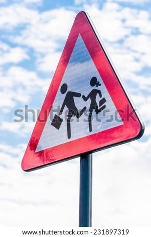 Shiny school street sign with clouds reflections and sky background. - stock photo