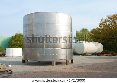 shiny silo stored outside for further processing