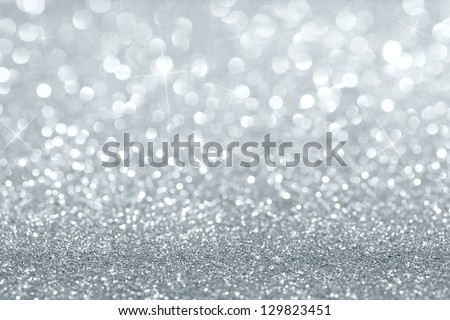 Shiny silver defocused glitter background with copy space - stock photo