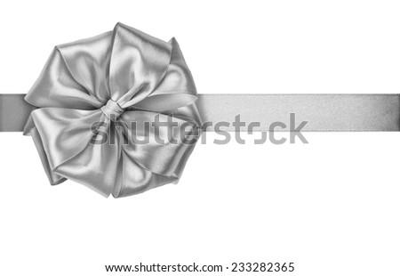 Shiny Silver satin ribbon on white background - stock photo