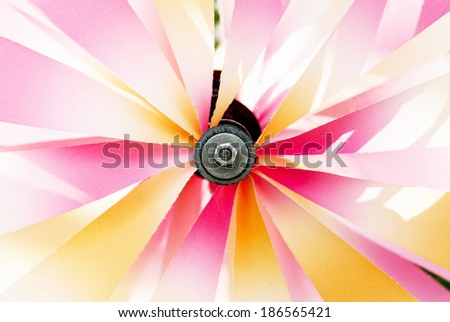 Shiny spinning colorful pinwheel on the wind. - stock photo