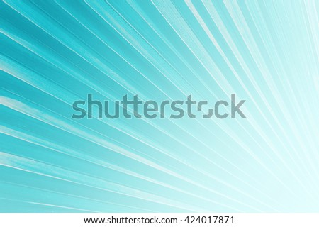 Shiny sunbeams, Bright sunbeams on blue background, Abstract bright background, Blue background - stock photo