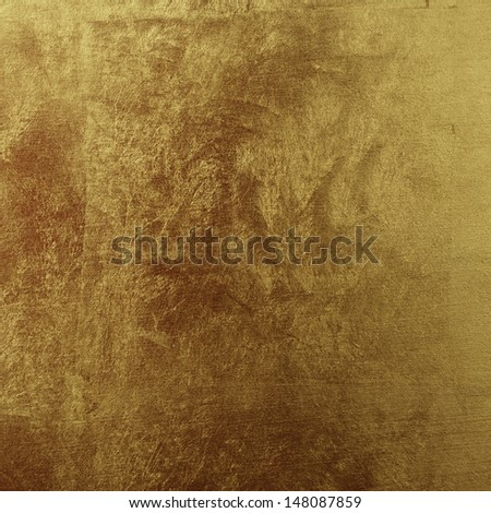 Shiny textured background painted in gold - stock photo