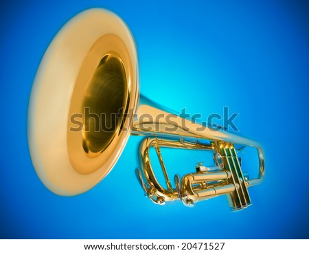 shiny trumpet on blue - stock photo