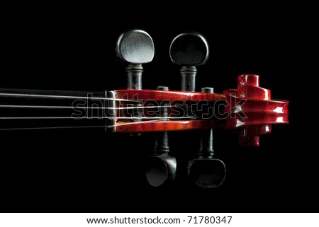 shiny violin scroll closeup isolated on black background - stock photo