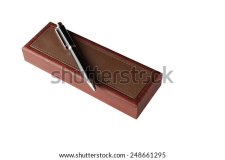 Shiny wooden pen box and pen - stock photo