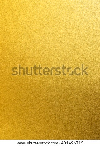 Shiny yellow gold golden paper foil decorative texture background: Bright brilliant festive glossy metallic look textured backdrop:  Metal steel like material pattern surface for design decoration - stock photo