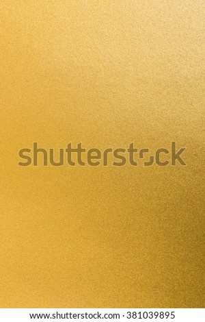 Shiny yellow gold paper golden foil decorative texture background: Bright brilliant festive glossy metallic look textured backdrop: Metal steel like material pattern surface for design decoration - stock photo