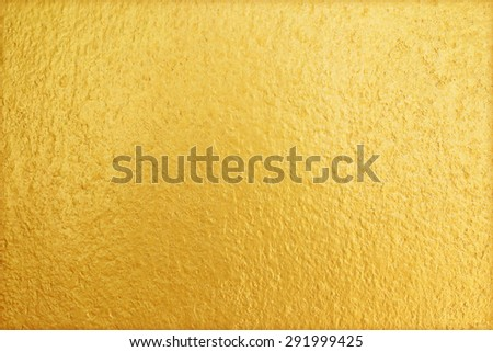 Shiny yellow gold wall texture background