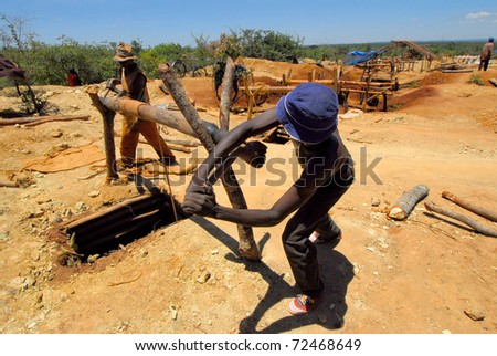 SHINYANGA, TANZANIA-MARCH 18: Unidentified miners look for gold March 18, 2010 in Shinyanga, Tanzania. Tanzania is the third gold producer in Africa after Ghana and South Africa. - stock photo