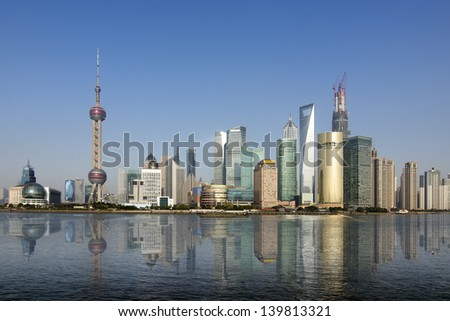 Ship after the Shanghai skyline in 2013 - stock photo