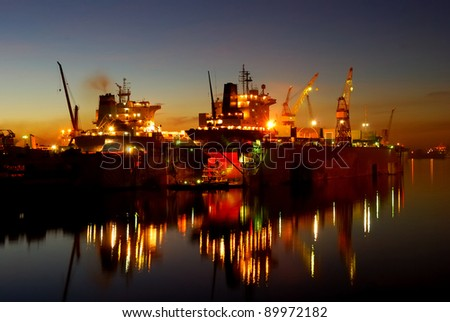 ship are being fixed at the shipyard docks by night. Riga, Latvia - stock photo