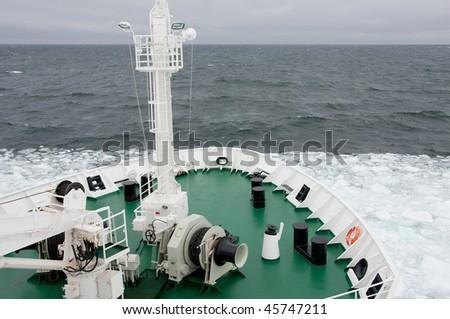 Ship at sea ice edge - stock photo