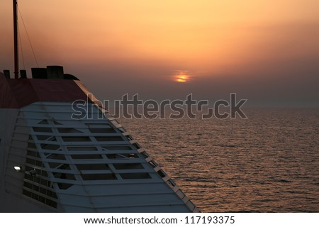 Ship at sunset. The ferry route Italy - Greece, near Bari. Italy. Mediterranean. - stock photo