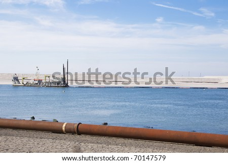 Ship at the coastline in the water. - stock photo