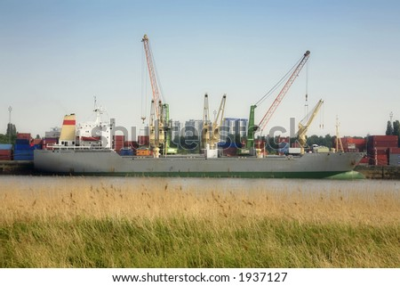 Ship at the river Scheldt (port of Antwerp, Belgium) Sight from the left bank - stock photo