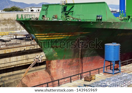 Ship bow being cleaned in a Gibraltar drydock - stock photo