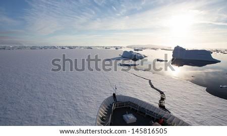 Ship Breaking Ice in Antarctica - stock photo