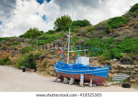 Ship building of new boards. boat building. repair of old fishing boat - stock photo