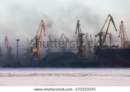 Ship crane in port load coals - stock photo
