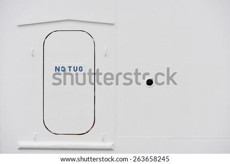 Ship door with inscriptions - stock photo