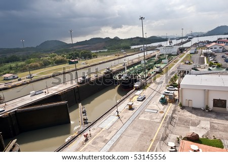 Ship entering Miraflores locks in Panama canal - stock photo