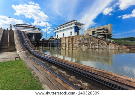Ship exits locks at the Panama Canal towards the Pacific Ocean. - stock photo